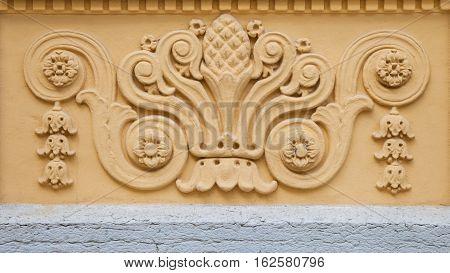 Rerto fretwork ornament on yellow building wall.