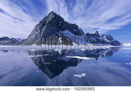 MOUNTAIN REFLECTED IN SEA SPITSBERGEN NORWAY lovely sky
