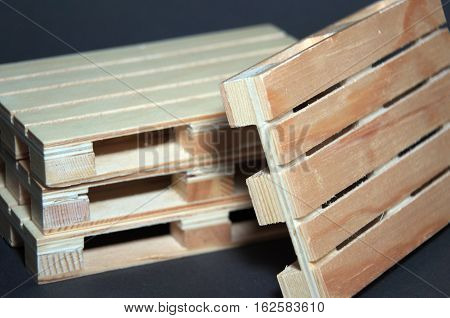 Close view of stack wooden pallets. Flat transport structure for support of goods.