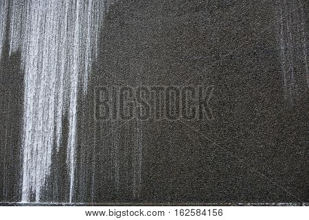 Gray wall of stained concrete. Universal background