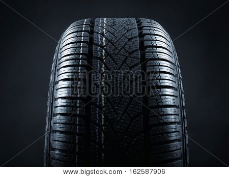 profile of a tire against a black background