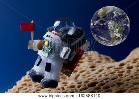 Spaceman floating stratosphere, planet earth blue sky as backdrop. Light bulb toy character dressed in spacesuit astronaut ammunition. Elements of this image furnished by NASA.