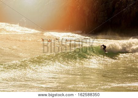 surfing - surfer on the wave at sunset