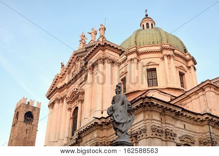 The statues of the Piazza del Duomo or Place Paolo IV at sunset in Brescia - Lombardy - Italy