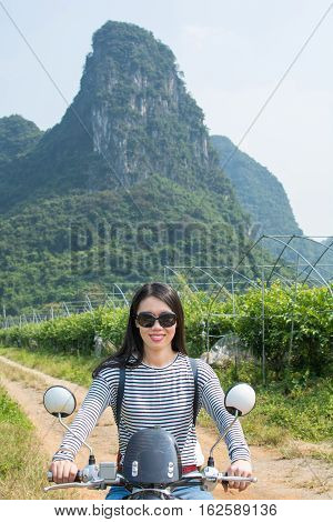 Girl On Motorbike In The Scenic Nature Area