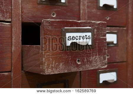 Secrets files concept image. Opened box archive storage, filing cabinet interior. wooden boxes with index cards. library service information management. shallow depth field