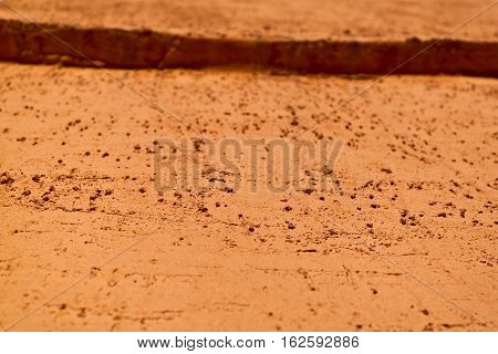 Plaster, plaster yellow color on a concrete wall. Stucco ochre wall background or texture. Plaster, plaster texture, plaster background. Yellow wall. Color plaster. Terracotta color wall. Terracotta wall.