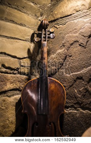 Violin in vintage style on stone background