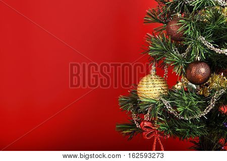 Beautiful Christmas Green Tree With Ball On The Branches And Red Ribbon Bow On Red Background With E