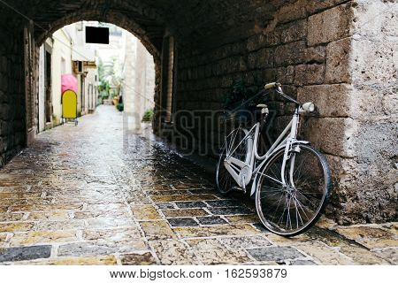 White vintage bicycle at old town in Budva Montenegro