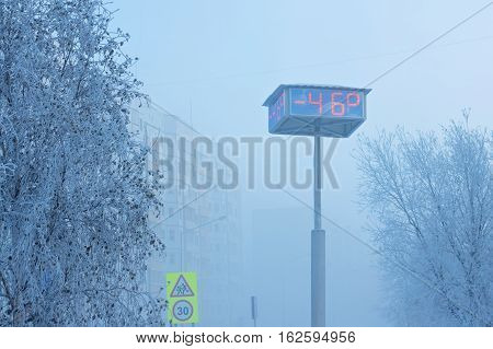 Temperature indicators on city board. Abnormally low air temperature-46 degrees. Russia Western Siberia.