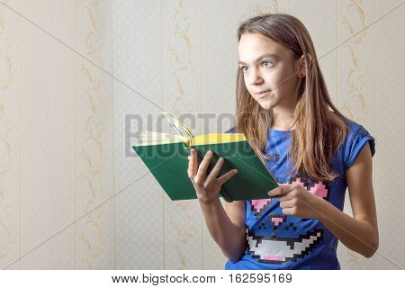 11 year old girl reading a book.
