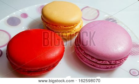 Macaron is a French confection of egg whites, powdered sugar, granulated sugar, ground almonds and food coloring.