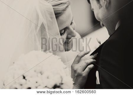 Shining Smile Of A Good Wife - Bride Pin A Boutonniere On Fiance's Suit