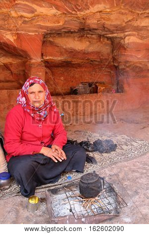 PETRA, JORDAN, MARCH 12, 2016: Portrait of a bedouin woman preparing tea