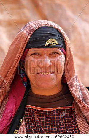 PETRA, JORDAN, MARCH 12, 2016 : Portrait of a bedouin woman nicely dressed