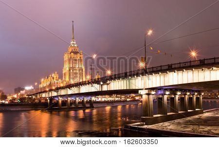 Night view of Moscow from the illumination lights. The picturesque bridge in the center of the Russian capital. The Radisson Royal Hotel is a historic five-star luxury hotel in Moscow city centre.
