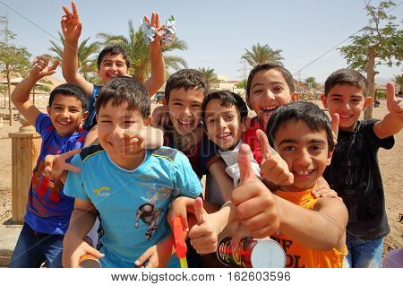AQABA, JORDAN, MARCH 15, 2016 : Welcoming and lively children on a beach