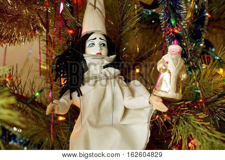 Toys in the form of Santa Claus and Piero under a New Year tree