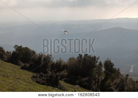 Hang glider flying in the mountains in North Greece
