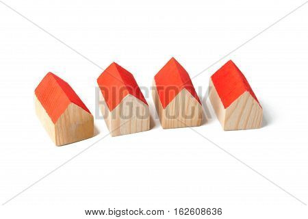 Small wooden houses on white background in studio
