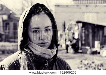 Crying girl. Puffy eyes tears on face. Emotional portrait of beautiful brunette. Depression and sadness. Toned black and white color processing. Nice soft warm light
