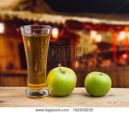 Apple Juice In A Glass On A Table