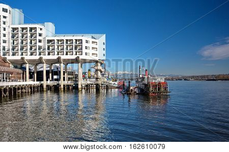 Hotel on the riverside , promenade, restaurant and cruise  paddle wheeler.