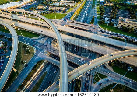 Interchange , Loops , and Highways Interstate 35 and Toll Road 45 Austin Texas Transportation. Intersections at busy Round Rock - Austin Texas Interstate and Highways crossing and turning. Aerial Drone Bird`s eye view of Texas Hill Country highways