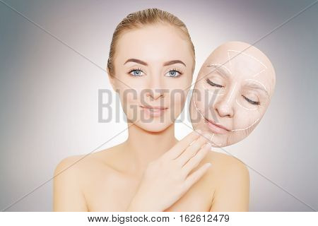 woman releases her face from wrinkles and bad skin