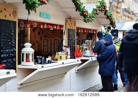CLUJ-NAPOCA ROMANIA - DECEMBER 17 2016: People buy street food and have a hot drink at the Street Food Festival winter edition. Food trucks sell tasty fast food from different cultures