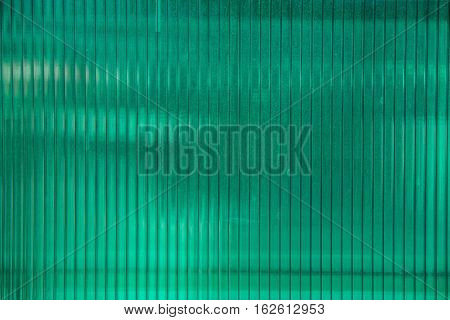 Green plastic sheet of polycarbonate on the building