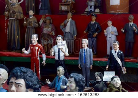 Naples Italy - December 9 2016: San Gregorio Armeno painted statuettes handmade representatives famous celebrities sports politics music and religion. They distinguish the formuna one pilot Michael Schumacher Matteo Renzi Mario Monti.