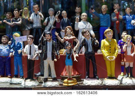 Naples Italy - December 9 2016: San Gregorio Armeno painted statuettes handmade representatives famous celebrities sports politics music and religion.