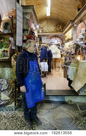 Naples Italy - December 9 2016: Workshop and artisan stalls in the heart of the city. San Gregorio Armeno the most famous street in the world for the sale of cribs and commemorative statues.