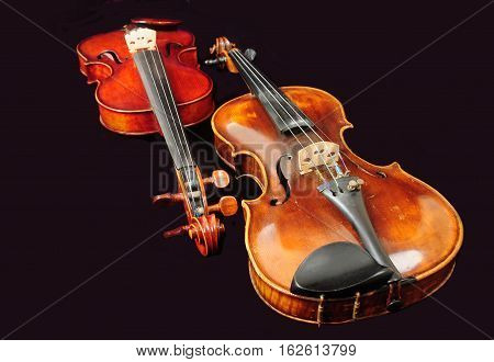 Two Violins, Isolated On Black Background. Music.
