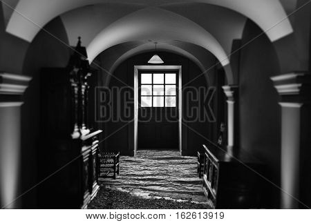 Artistic black and white edit of manor house interior
