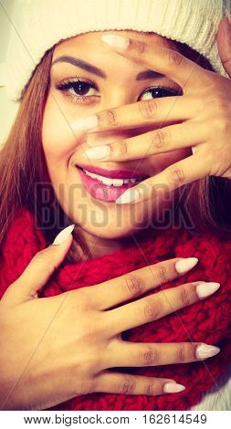 Fashion style people concept. Woman showing off with nails. Young attractive mulatto girl is wearing red scarf.