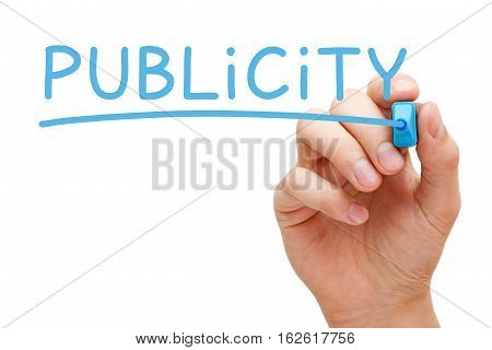 Hand writing the word Publicity with blue marker on transparent wipe board.