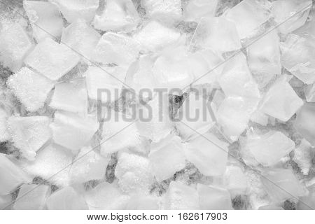 Fresh background made of ice cubes up view
