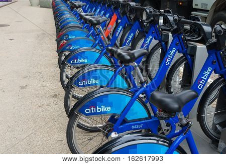 NEW YORK - APRIL 27 2016: Rental bikes in downtown manhattan. Citi Bike is a privately owned public bicycle sharing system that serves parts of New York City. It is the largest bike sharing program in the United States