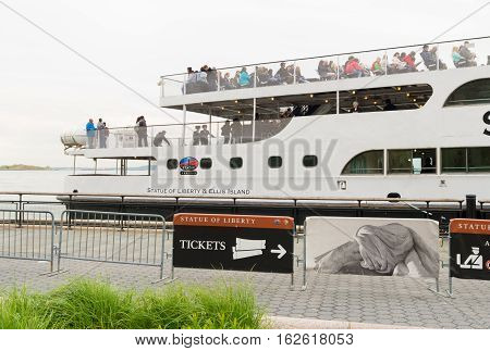 NEW YORK - APRIL 27 2016: Statue Cruises ferry boat at Battery park in lower Manhattan. the company provides ticketing service and transportation for visitors to the Statue of Liberty National Monument and Ellis Island Immigration Museum