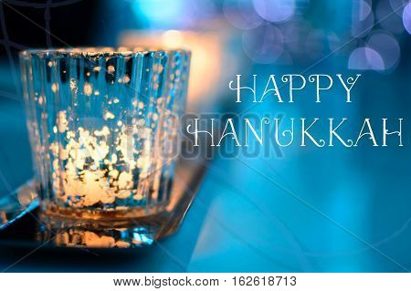 Happy Hanukkah candle light image A row of sparkling candles in a beautiful blue warm glowing holiday background with room for copy or message for social networks community friends and followers greeting card