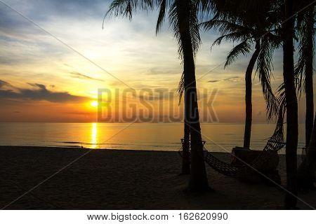 Sunrise and cradle at Ban Krut Beach Prachuap Khirikhun Province Thailand