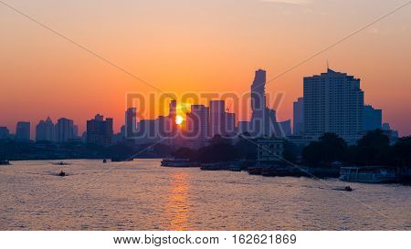 Sunrise Over The Scenic Skyline At Bangkok, Thailand, Viewed In Backlight At Sunrise With Orange Red