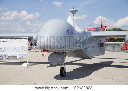 BERLIN / GERMANY - JUNE 32016: IAI Heron a medium-altitude long-endurance unmanned aerial vehicle (UAV) stands on airport in berlin