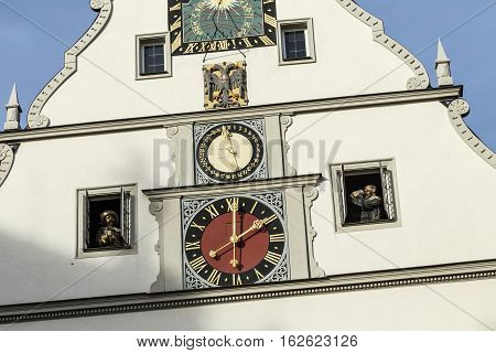 Peak Of A Building With A Clock Against A Blue Sky In Rothenburg   Germany