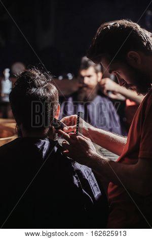 Man Has Haircut In Barbershop