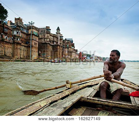 Authentic boatman on the river Ganges in Varanasi. Boat trips are one of the most popular tourist activities in Varanasi Indi