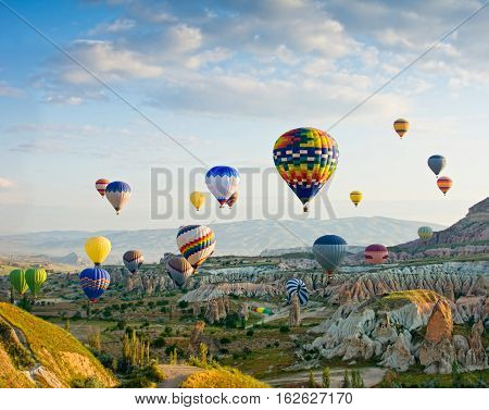 GOREME/ TURKEY - MAY 25, 2015: Hot air balloons take off in Cappadocia on may 25, 2015 in Goreme, Anatolia, Turkey.